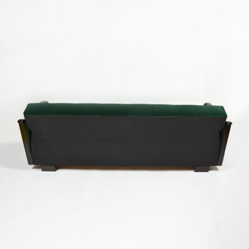 Dark green velvet sofa