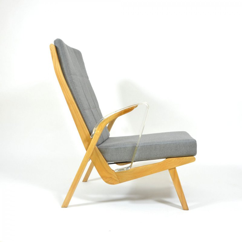 Unique retro armchair with plexiglass armrests
