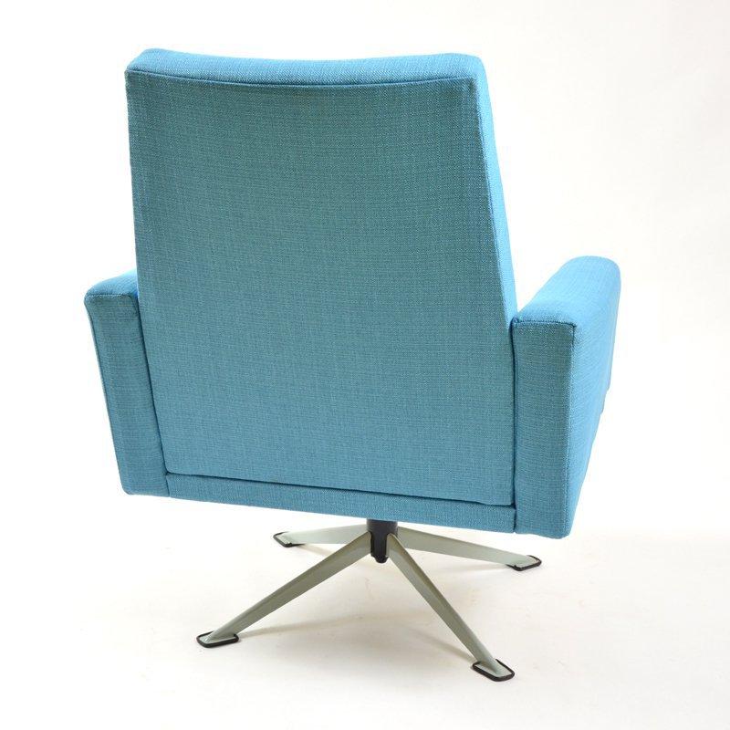 Blue swivel armchair